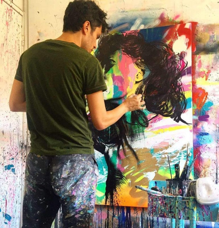 JM Robert en train de peindre
