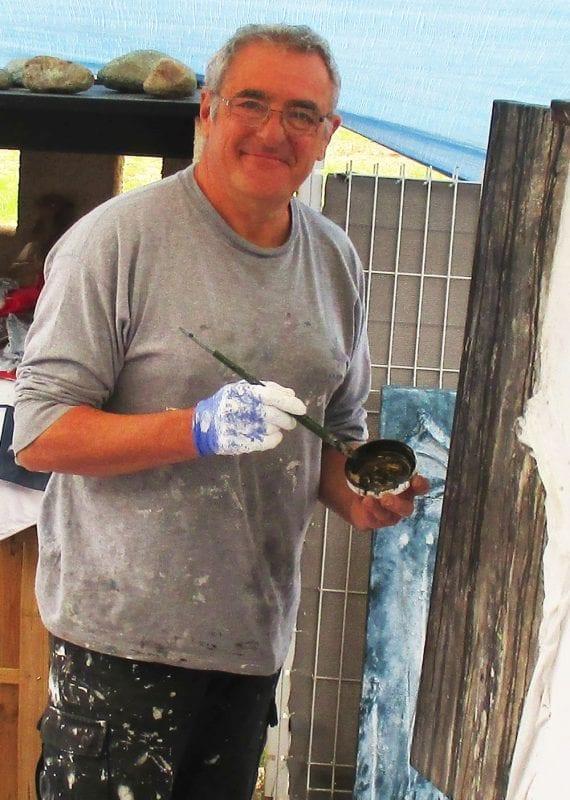 Patrick Demelenne en train de peindre