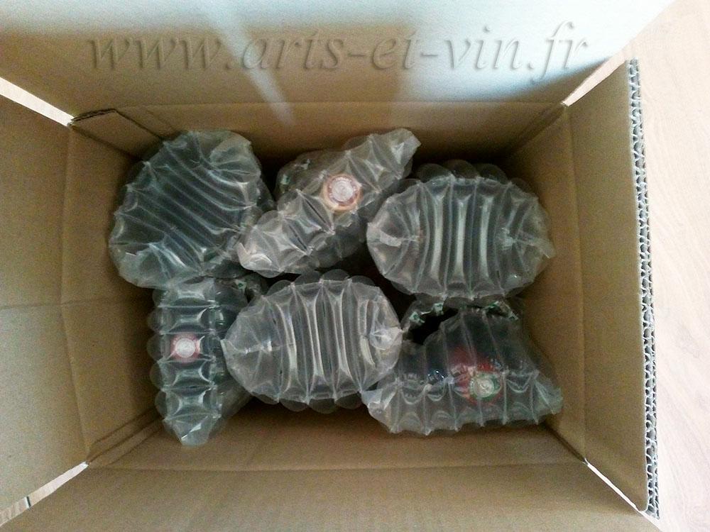 Carton rempli avec bouteilles protegees dans embalage gonflable