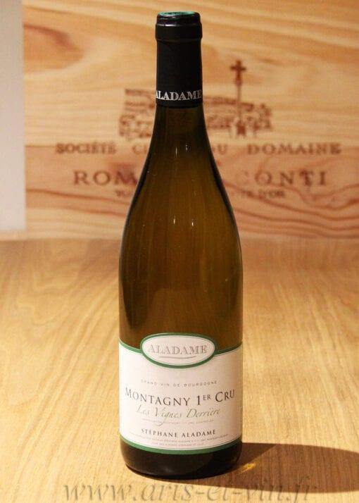 bouteille Montagny 1er Cru Les Vignes Derriere Aladame sur table en bois