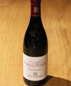bouteille Gigondas Terrasses de Montmirail Alain Jaume sur table en bois